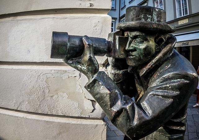 dies ist die statue eines fotografen