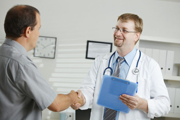 Doctor greating male patient